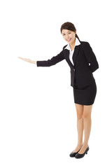 asian Businesswoman with her arm out in a welcoming gesture