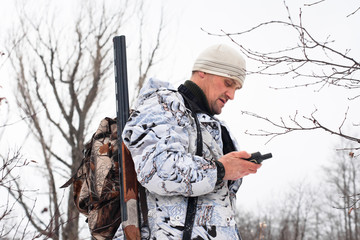 hunter looking on the mobile  navigation device