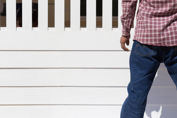 man wear clothing blue jeans standing with white wood background