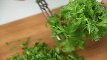 Cutting a bunch of fresh parsley with herb cutters.