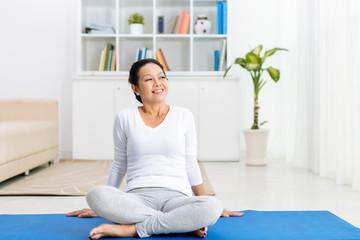 Sitting on yoga mat