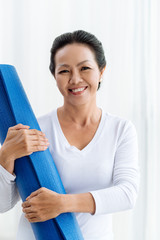 Vietnamese woman with yoga mat