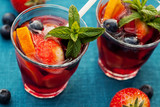 Fototapeta Refreshing sangria (punch) with fruits, picnic idea