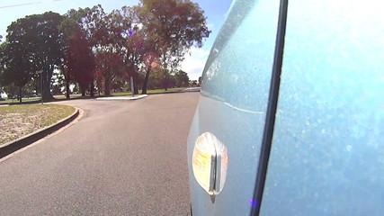 Driving shot low angle front wheel indicator flashing