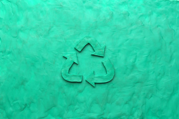 Recycle symbol made from green clay