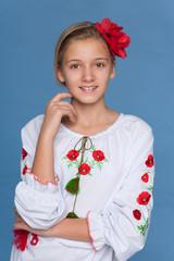 Ukrainian girl against the blue background