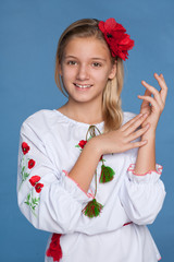 Ukrainian girl on the blue background