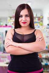 Overweight girl on blured background