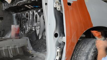 engineer working repair on car body before painting