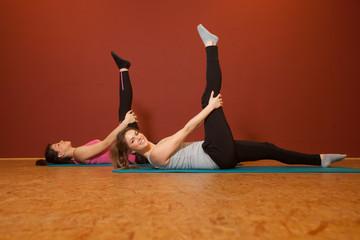 Fitness Training - 2 girls streching - warmup