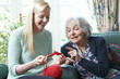 Grandmother Showing Granddaughter How To Knit - 76145401
