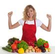 canvas print picture - Hausfrau mit roter Schürze freut sich auf frisches Gemüse
