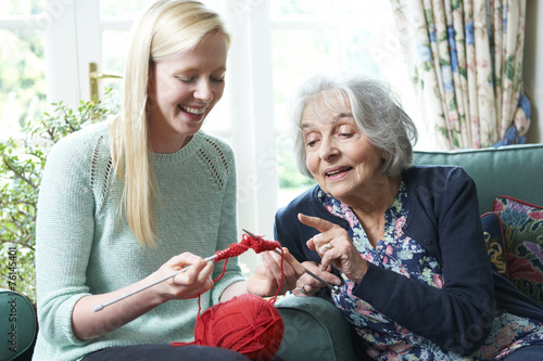 Fototapeta Grandmother Showing Granddaughter How To Knit