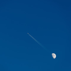Plane and moon in the sky