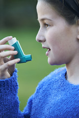 Girl Using Inhaler To Treat Asthma Attack