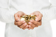 Savings, close up of female hands holding gold coins
