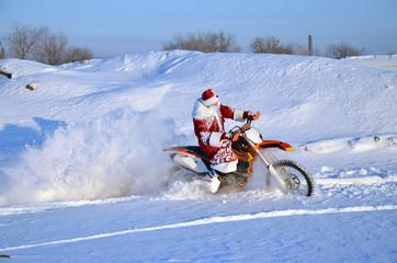 Santa Claus astride on the motocross bike