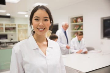 Pretty science student smiling at camera