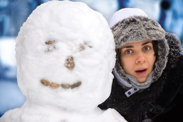 Young woman with snowman