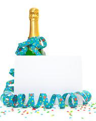 Champagne bottle behind blank sign