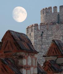 Yedikule Zindanlari on background of fool moon, Istanbul