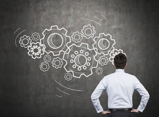 businessman thinking with geers and cogs over head