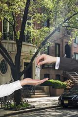broker handing a key