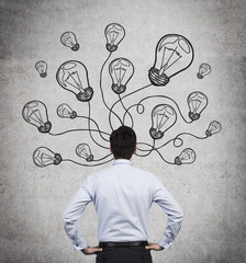 businessman with drawing bulbs