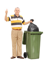 Senior giving a thumb up by a trash can