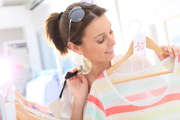 Beautiful woman in clothing storesduring summer sales