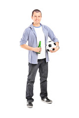 Young football fan holding a beer