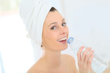 Beautiful woman drinking water from bottle