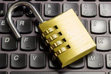 Open combination padlock on a keyboard symbolizing data security
