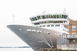 Bow and Bridge of White Luxury Cruise Ship at Pier