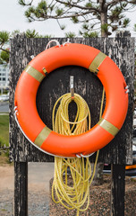 Orange Life Ring and Yellow Rope