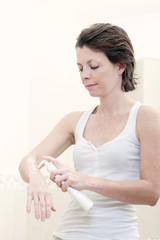 30s Woman Applying Moisturising Cream