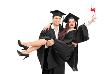Young couple celebrating their graduation