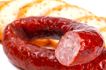 Traditional Polish smoked sausage and sliced bread