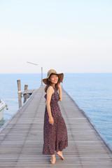 portrait beautiful woman wearing wide straw hat and long dress w