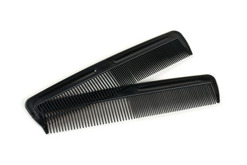 two black combs for hair isolated on white