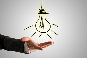 Conceptual Bulb Drawing Over Businessman Hand