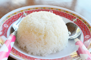 Cooked Rice with spoon and fork