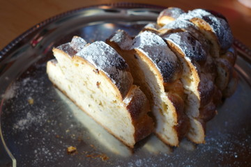 Christmas sweet bread with sugar on silver tray