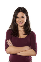 happy young woman with hands folded