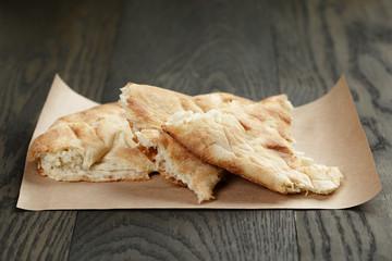 freshly baked georgian pita bread on paper
