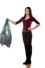 happy young woman holding garbage bag on white background