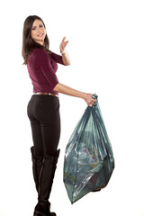 nervous young woman holding garbage bag and complaining