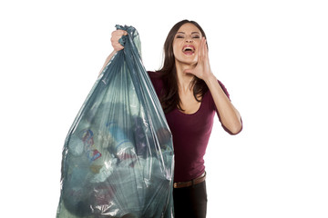 nervous young woman holding garbage bag and shouting