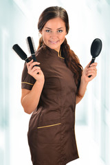 Professional hairdresser holding brushes