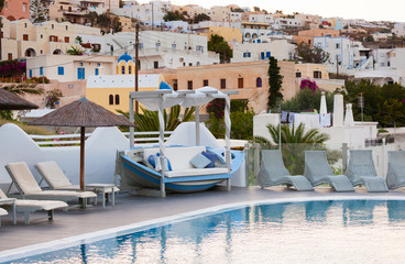 View of Fira town from a resort with swimming pool.